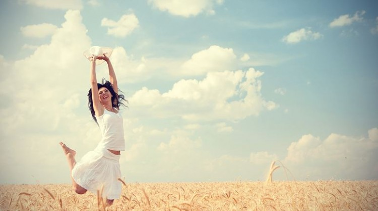 Happy-woman-jumping-in-wheat