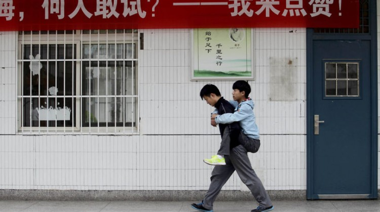 Student-Carries-His-Disabled-Classmate-To-School-Every-Day-For-3-Years