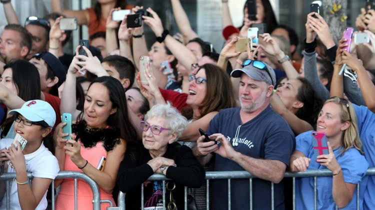 old-woman-living-in-moment-no-smartphone-celebrities-movie-premiere-black-mass